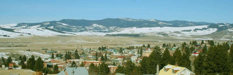 Autumn snow on the ground looking across Philipsburg, Montana